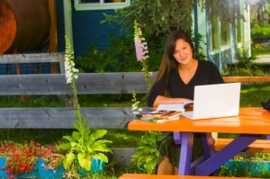 Alaskan woman doing homework at picnic bench